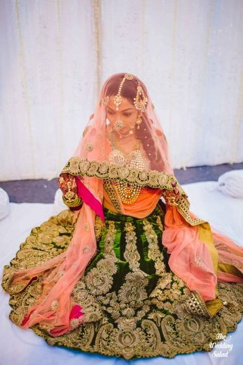 Photo of velvet forest green lehenga with salmon colored dupatta