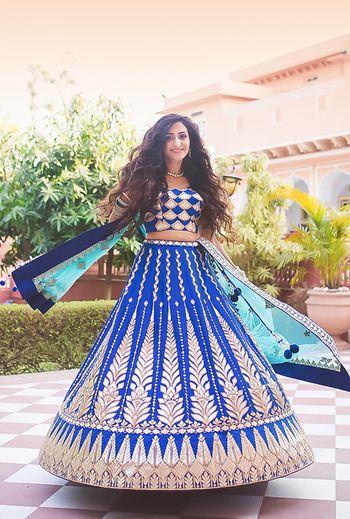 Royal blue lehenga on twirling bride
