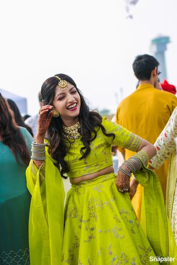 Photo of A bride to be in green dancing on her mehndi function
