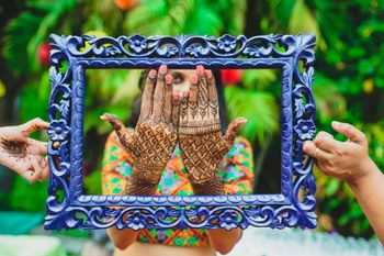 Mehendi hands inside blue frame
