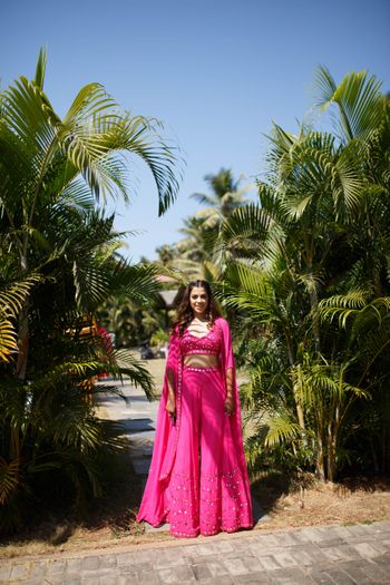 Photo of bright pink indo western outfit for summery mehendi