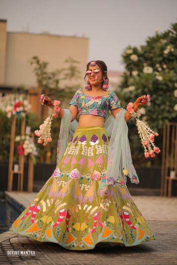 bride wearing multicolour patchwork lehenga by aisha rao on mehendi