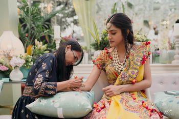 Photo of red and yellow anamika khanna lehenga for mehendi