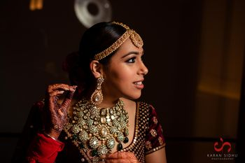 Photo of grand bridal necklace set with velvet lehenga