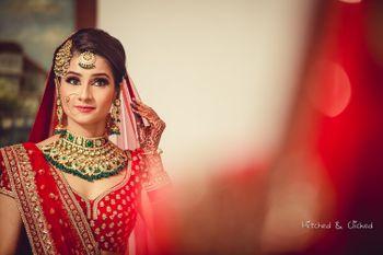 Bride looking into mirror shot
