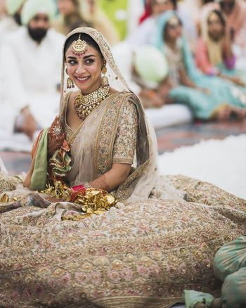 Ivory and gold bridal lehenga by Sabyasachi