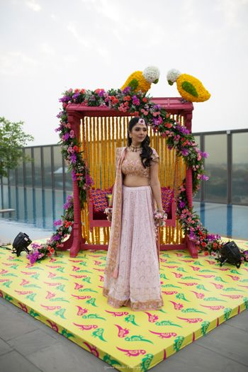 Photo of Mehendi bridal swing with floral bird decor