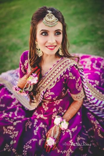 Photo of Mehendi bridal look aubergine lehenga