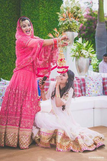 Bride dropping kaleera on sister