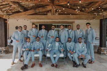 Photo of Groom with groomsmen in colour coordinated outfits!