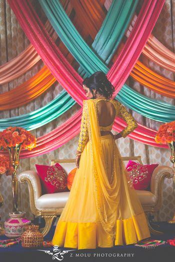 Bridal back with full sleeved yellow lehenga