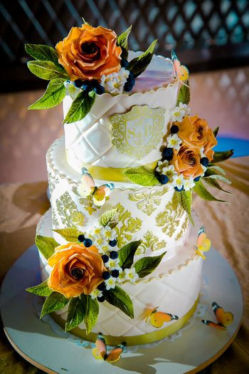 Photo of White and yellow wedding cake by Firefly