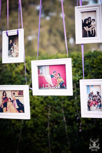 Photo of Hanging frames with couple photos