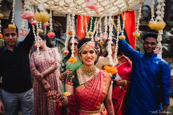 Photo of South indian bridal entry shot under chadar