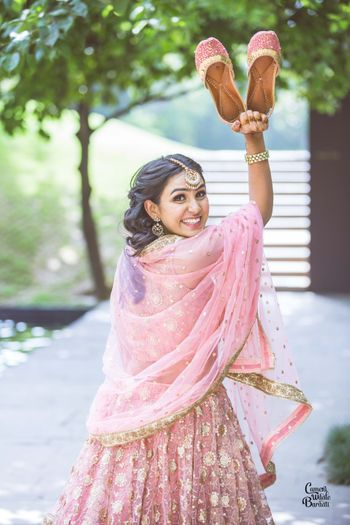 A bride to be in a baby pink outfit for her mehndi