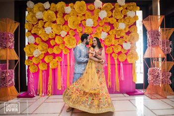 Photo of Mehendi decor ideas with paper flower backdrop