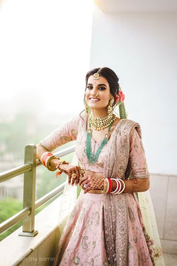 Photo of Happy pastel bride contrasting jewellery