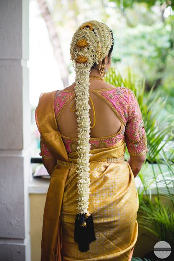 South Indian traditional bridal hairstyle with mogra flowers