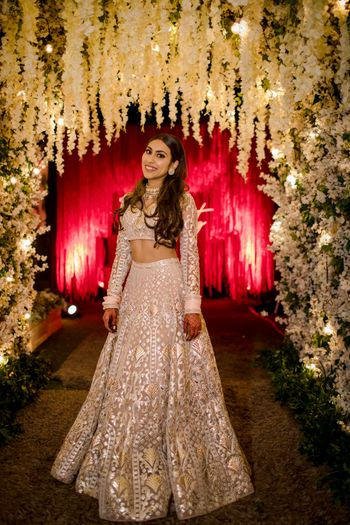 Bride dressed in an ivory & silver lehenga for the reception.