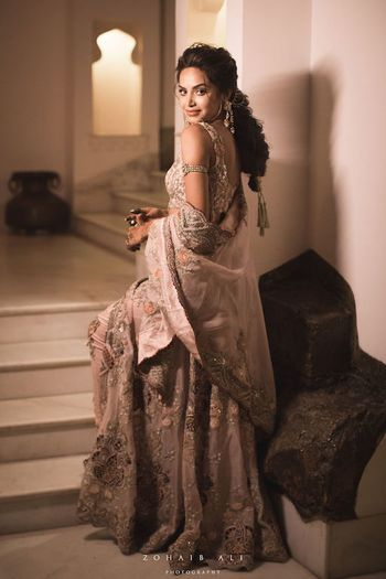 Photo of Bride in grey sangeet lehenga