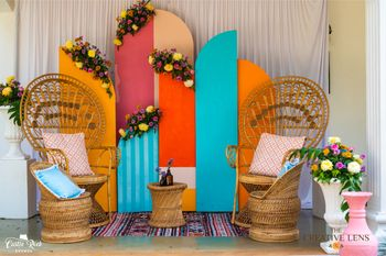 Cane chairs with colourful installations.
