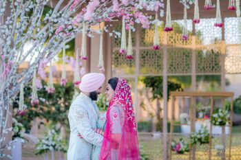 sikh couple shot on wedding day with coordinated outfits
