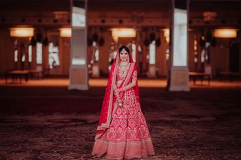 Photo of A bride in a red lehenga and double dupatta for her wedding