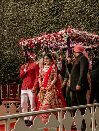 Photo of Bride entering under matching phoolon ka chadar