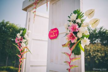 Photo of White wooden doorway entrance in garden engagement