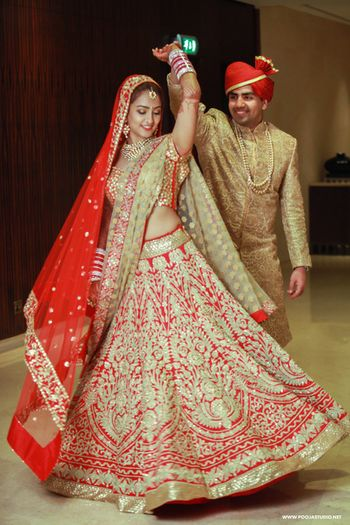 Red all over embrpidered bridal lehenga