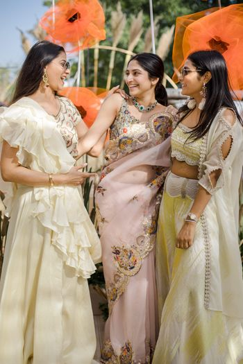 Bride posing with her bridesmaids.