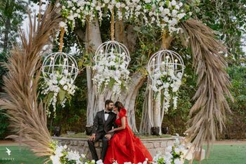Photo of Cute couple portrait under a floral decor setup
