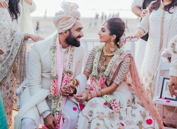 Pastel bride and groom in ivory outfits