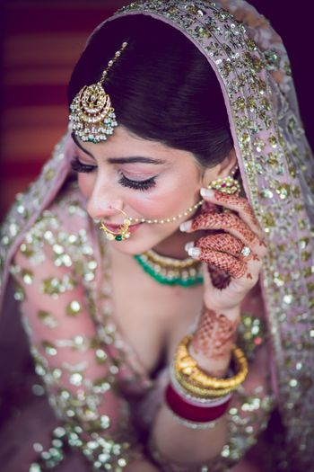 A pretty shot of the bride's subtle and light makeup with bold eyes.