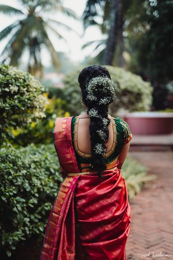 Fusion south indian bride with babys breath hair braid