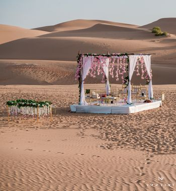 Gorgeous yet minimal mandap in the middle of a desert