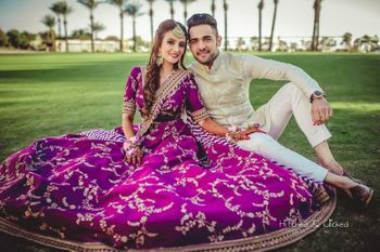 Mehendi photo couple aubergine lehenga