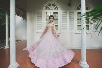 Bride in lavender wearing Anushree Reddy