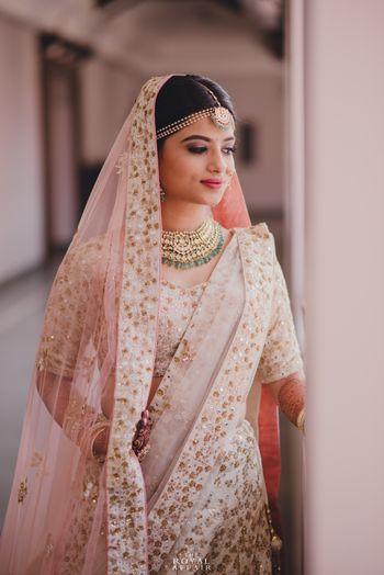 White Wedding Photoshoot & Poses Photo white and gold bridal lehenga