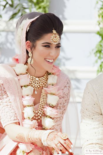 Photo of Happy bride shot with matching pastel jaimala