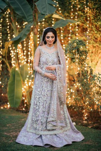 Photo of Bride dressed in a grey lehenga for her reception.