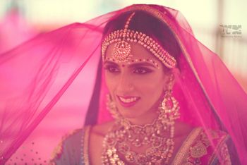 Photo of bride with fuschia pink veil