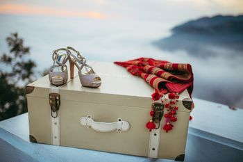 Bridal trousseau shot with shoes and dupatta