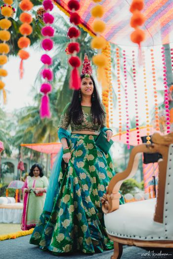 Bride wearing a dark green lehenga on her mehendi day