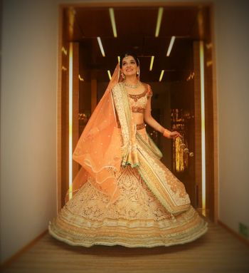Photo of Peach and Off White Lehenga with Lace and Embroidery