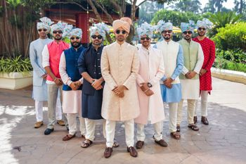 Photo of Groom and groomsmen in coordinated floral safa.