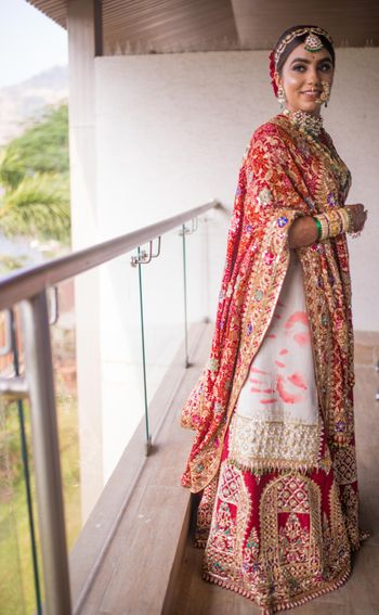 unique red and white bridal lehenga with handprints