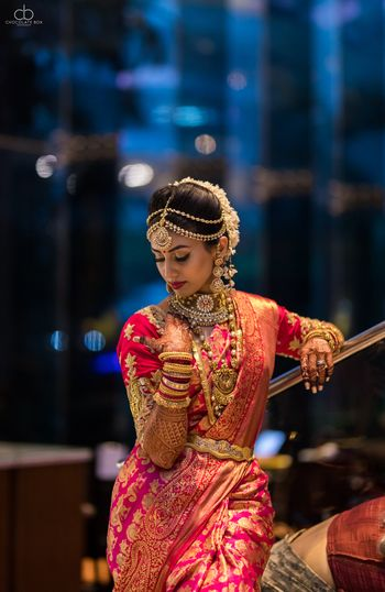 Photo of South Indian bridal look in red and gold kanjivaram