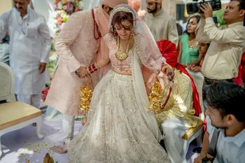 Photo of A beautifully candid shot of the bride and groom during the pheras!
