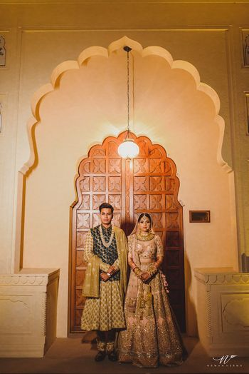Photo of Couple shot with unique sherwani